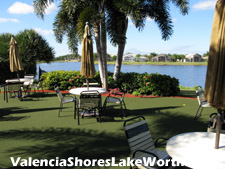An on-site cafe serves visitors to the social clubhouse. This popular Valencia Shores amenity offers seating indoors, on a shaded outdoor patio, and lakefront (shown).
