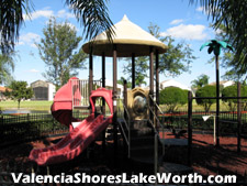 Young visitors to Valencia Shores will enjoy this playground with its multiple slides and climbing activities.